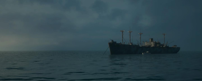ghost ship floats on a calm sea